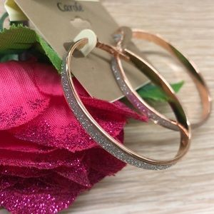 Elegant rose gold tone hoop earrings